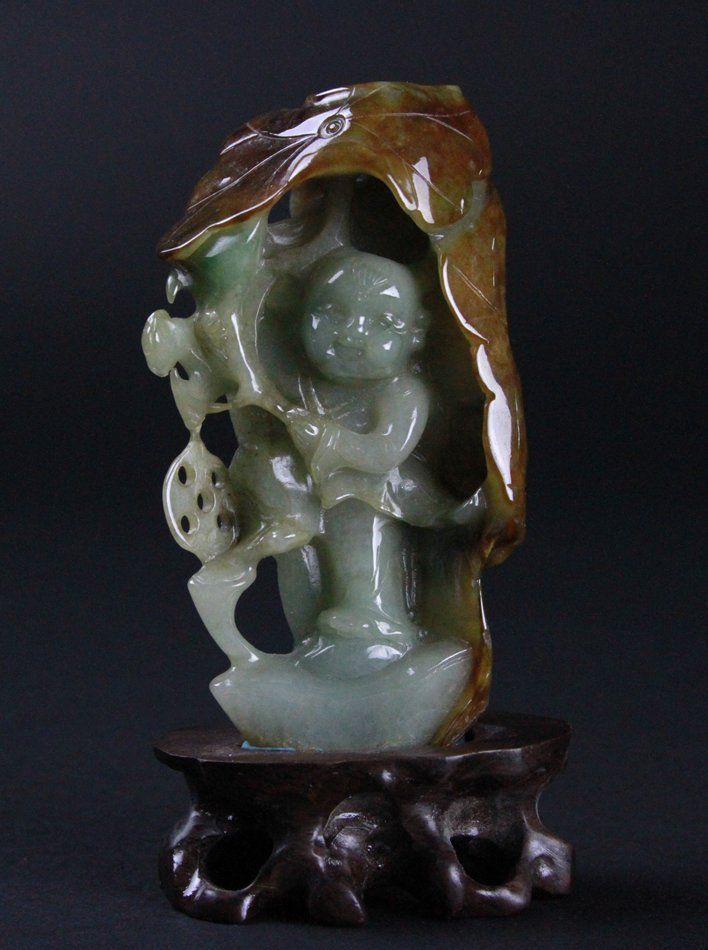 A FINELY CARVED JADEITE BOY