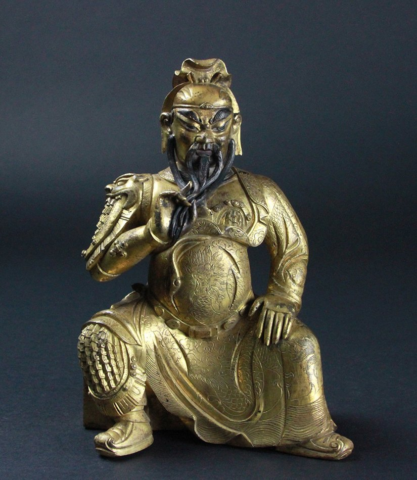 A CHINESE GILT BRONZE GUANGONG FIGURE