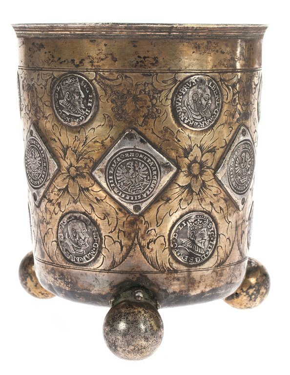 Silver cup with coins