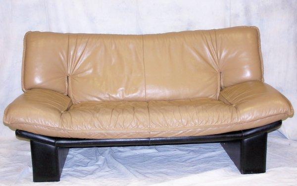 "508: Modern leather loveseat measuring 33""h x 34""d x 66"