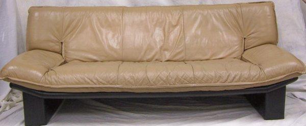 "509: Modern leather sofa measuring 33""h x 36""d x 84""w"
