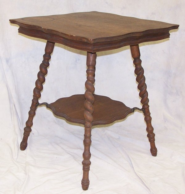 516: 19th c. two tier oak side table with burley twist