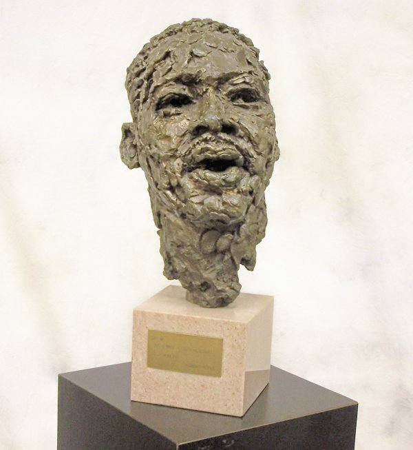 574: Bronze sculpted head mounted on polished granite o