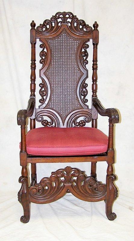 15: Elaborately carved Gothic Revival armchair. Measuri