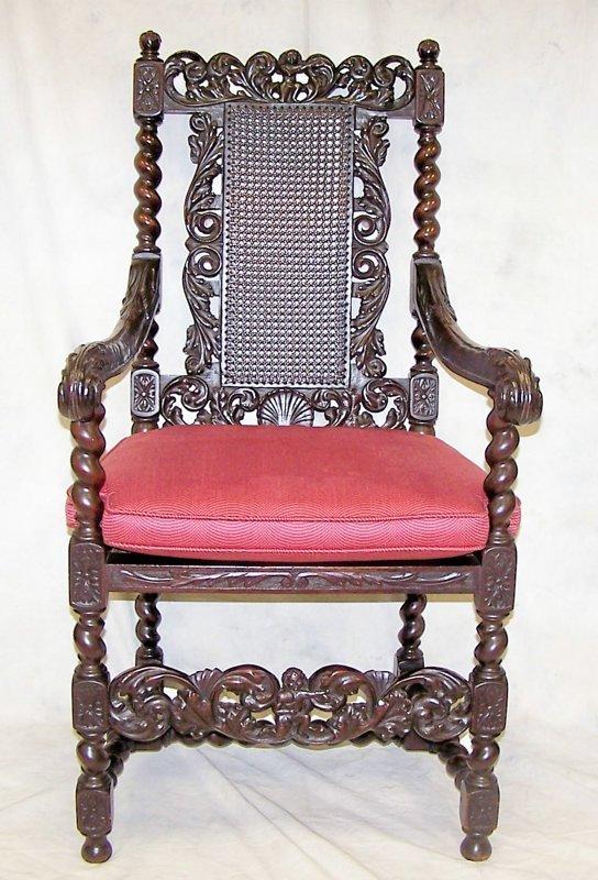 16: Elaborately carved Gothic Revival armchair. Measuri