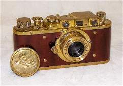 60: Leica brass and mahogany ship's camera Category: Ca