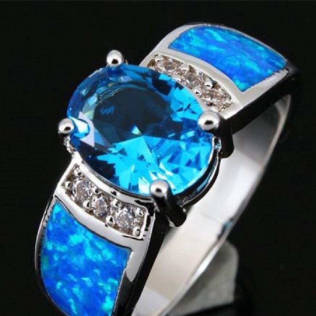 Stunning Fire Swiss Topaz  & Opal Ring