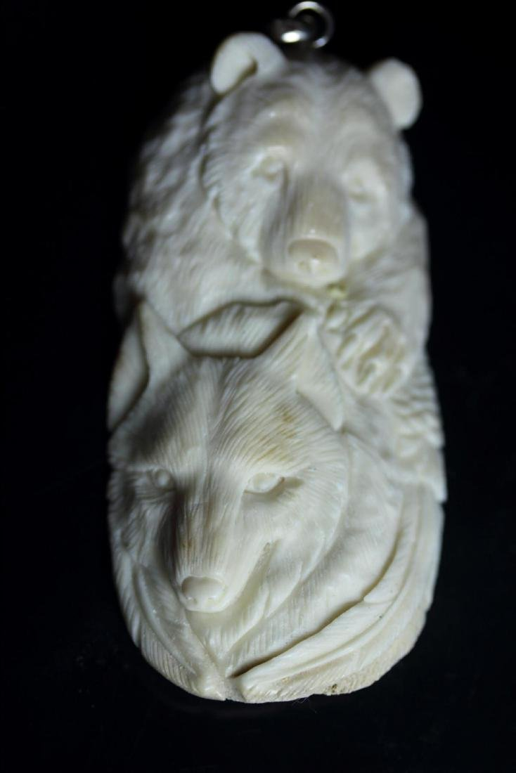 Hand Carved Bear & Wolf Pendant