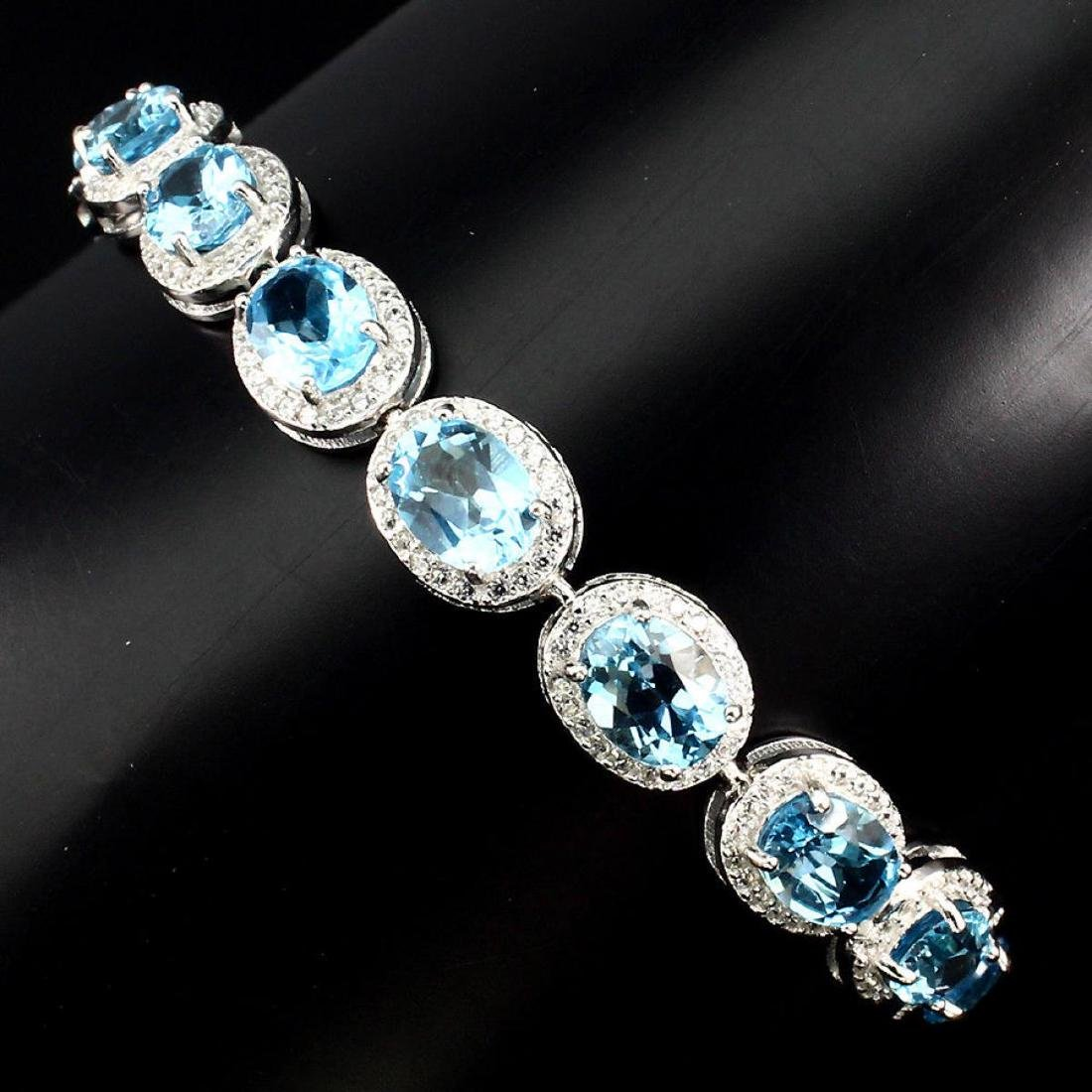 Natural Oval 8x6mm Swiss Blue Topaz Bracelet - 2