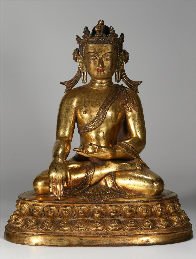 CHINESE GILT BRONZE FIGURE OF SEATED SHAKYAMUNI