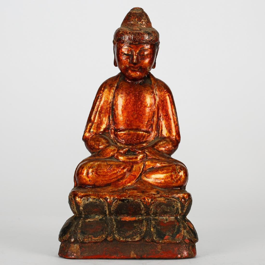 CHINESE GILT LACQUER WOOD FIGURE OF SEATED BUDDHA