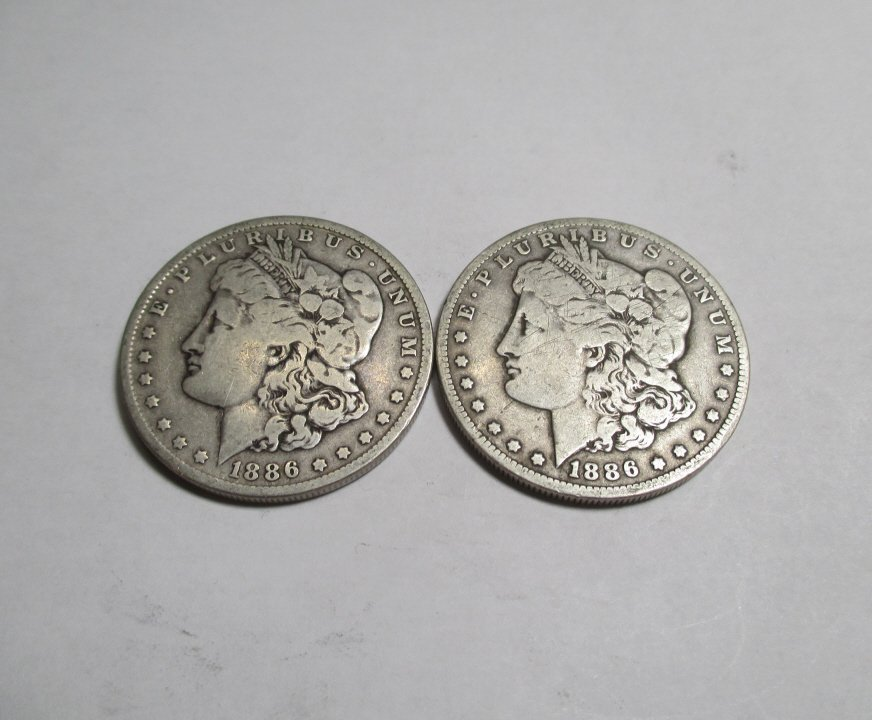 (2) Better Date 1886 O Morgan Silver Dollars