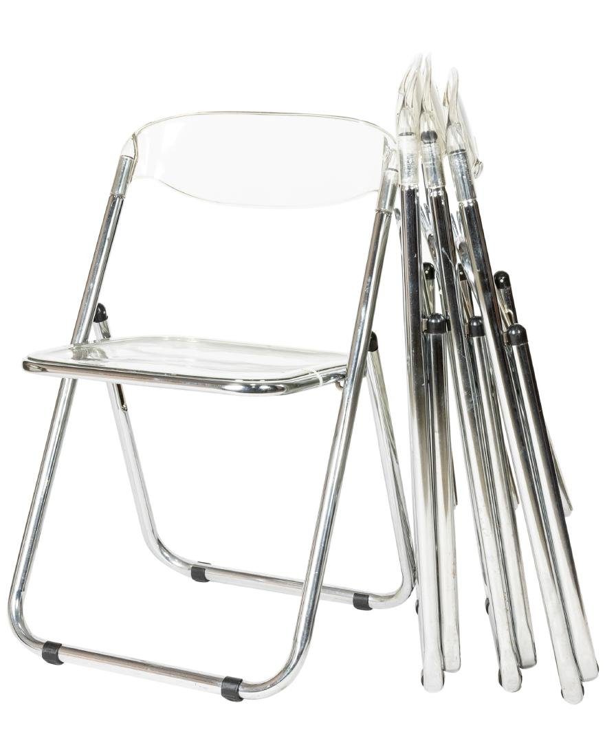 Four Lucite Folding Chairs