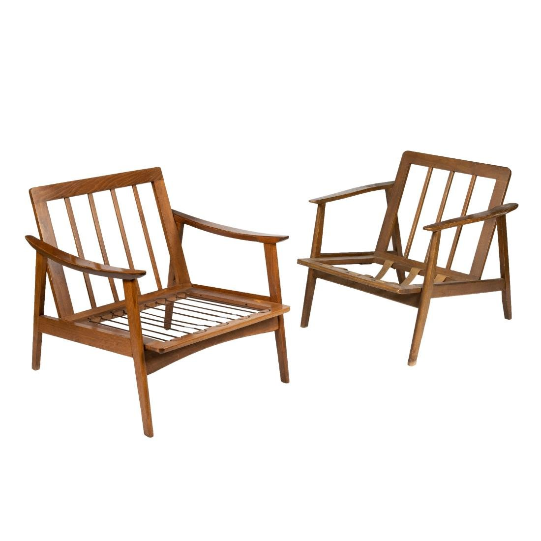 Two Paddle Arm Lounge Chairs