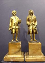 A PAIR OF RESTAURATION BRONZE FIGURES OF ROUSSEAU AND