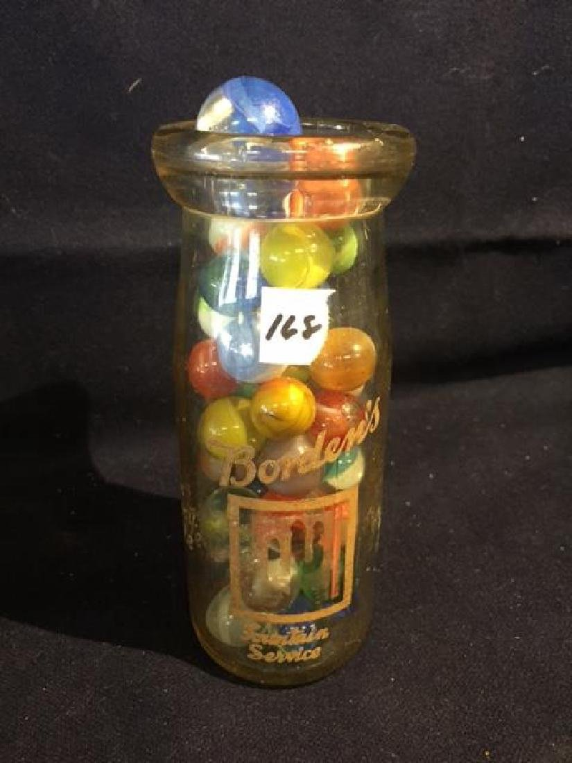 Vintage Milk Bottle Filled with Marbles and a Shooter