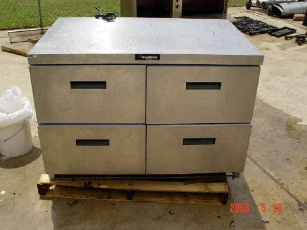"405: 48"" Delfield 4-drawer Refrigerator w/ casters"
