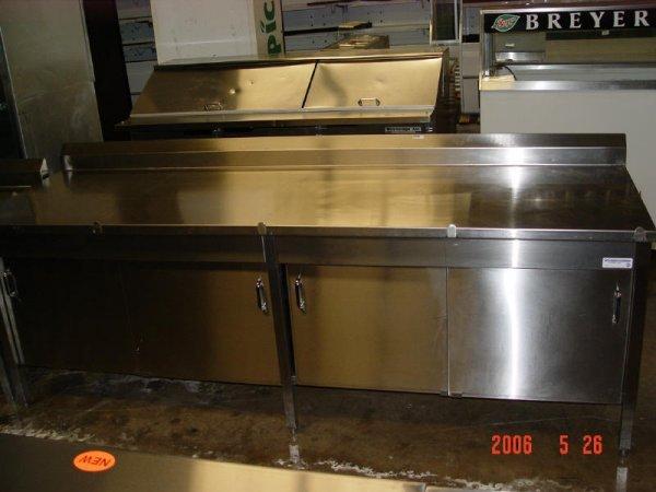 "147: 8'x30"" SS Table enclosed w/ sliding doors"