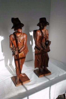 Pair of hand carved wood, black forest style, Swiss,