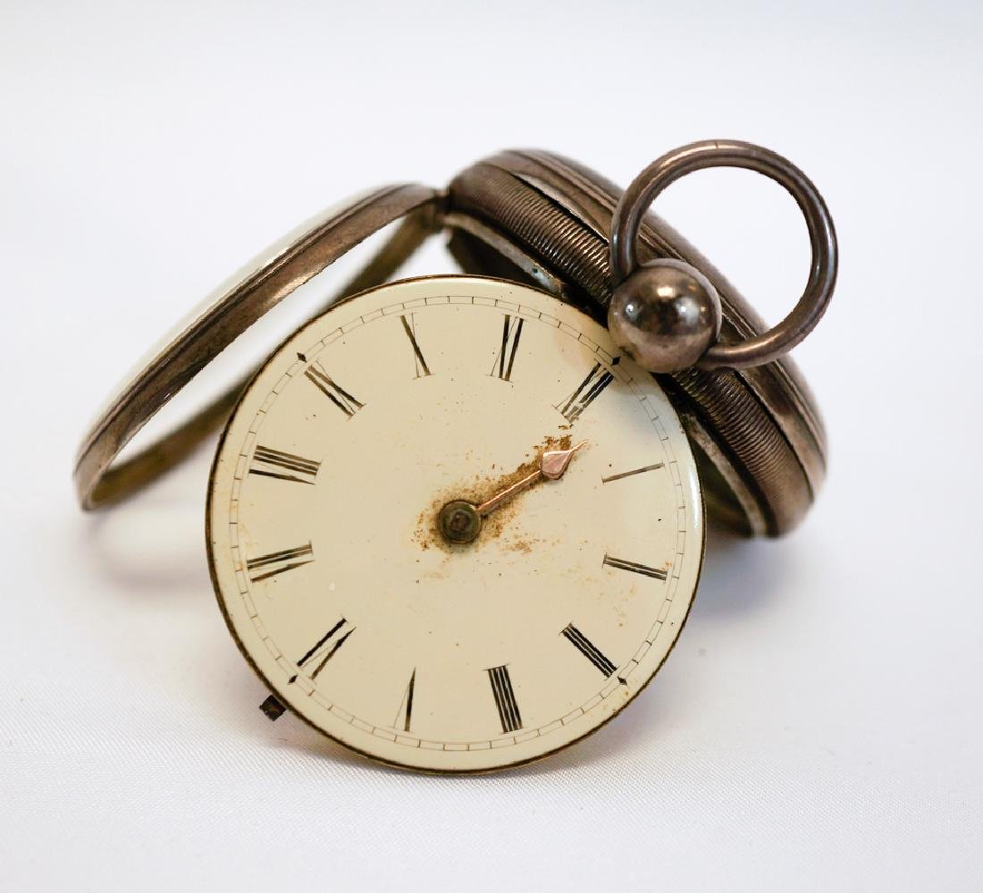 An Antique English Sterling Key Wind Pocket Watch.