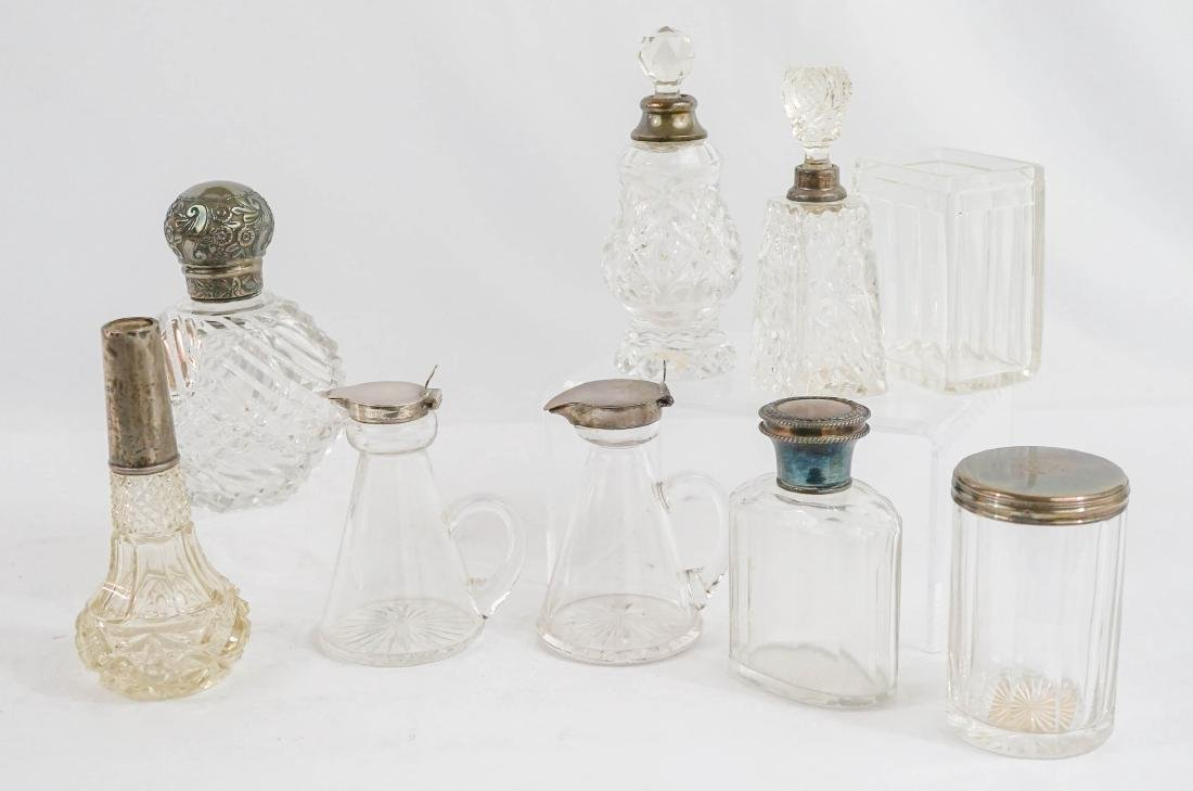 A Group of Dresser Bottles and Vanity Items