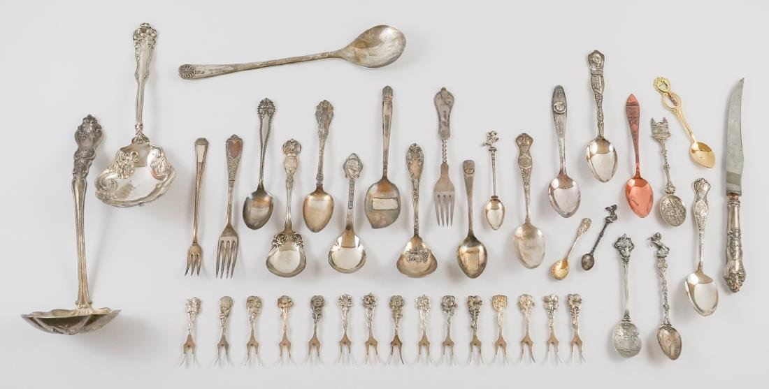 A Group of Ornate Silver Plate Serving Pieces
