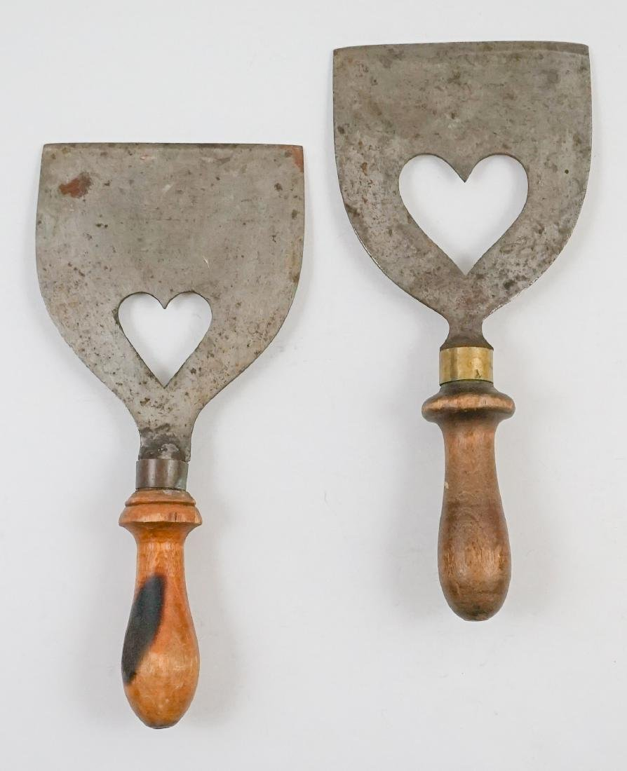 Two Antique Dough Scrapers with Heart Cut Outs