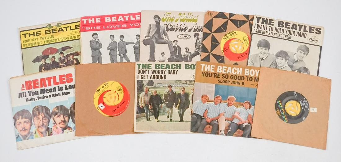 Group of Beatles 45's and More