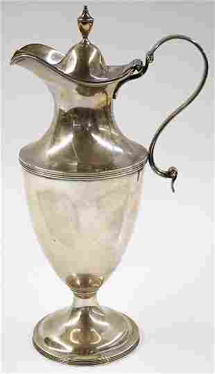 An Antique London Sterling Silver Hot Water Jug