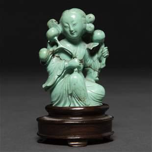 Dama con flores Figura realizada en piedra turquesa.