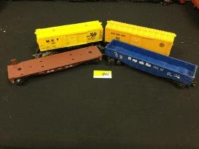 4 COUNT. ASSORTED VINTAGE LIONEL CARS.