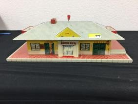 VINTAGE TIN  RAILROAD TRAIN STATION. TURN THE CRANK AND