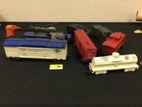 GRAB BAG OF VINTAGE RAILROAD CARS. 8 TOTAL. COUPLE OF
