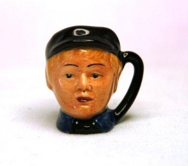 9: Royal Doulton 'Oliver Twist' Tiny Character Jug. D66
