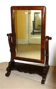 76: Rare A LENEHAN Cedar Cheval Mirror. With carved fee