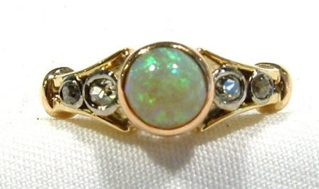 12: 18ct Yellow Gold Dress Ring. Set with central opal
