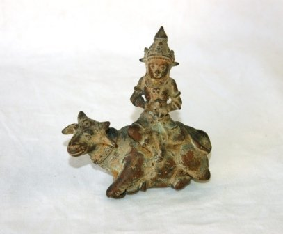 1017: Eastern Bronze Figure of Deity Seated on Ox.  H 1