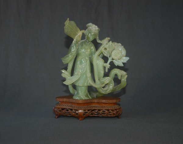 16: Chinese Jade Woman with Blossom.  Repair to fan. In