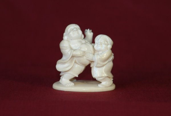 22:  Early Japanese Carved Ivory Group.  2 figures, 1 w