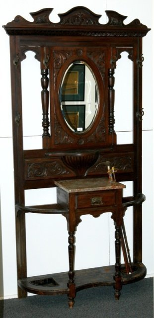 13: Edwardian Carved Pine Hallstand.  Oval mirror, 6 co