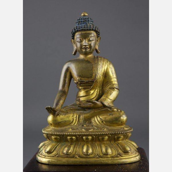 A Gilt-Bronze Figure of Buddha, Qianlong, 18th Century
