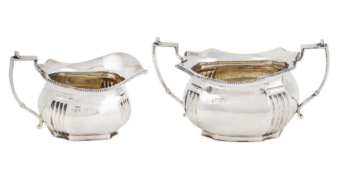 A silver sugar bowl and a milk jug London, 1914,