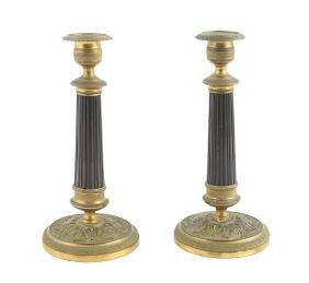 A pair of bronze candlesticks late 19th-early 20th