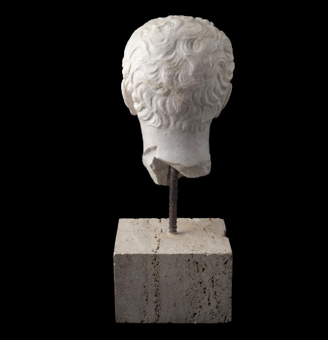 A white marble head Italy, late XVIII century h. 52 cm. - 2