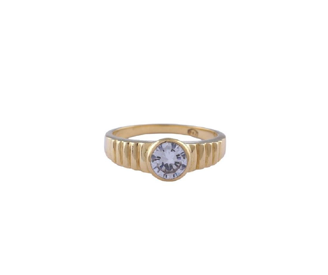 An 18kt gold ring with a diamond peso 6 gr. - 2