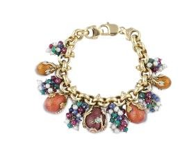 An 18k gold bracelet with charms peso 55 gr.