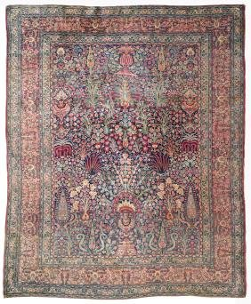 A Kirman carpet Iran, late 19th century 293x247 cm.
