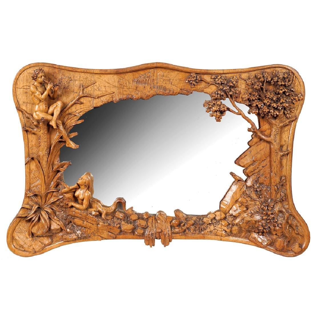 A lime wood wall mirror France 1900 50x85 cm.