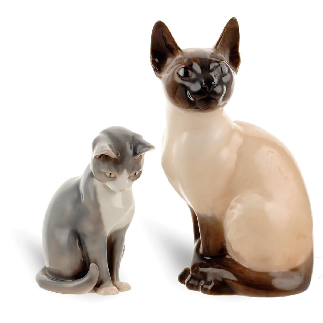 Two cat scuptures 20th century h. 20 cm. 12 cm.