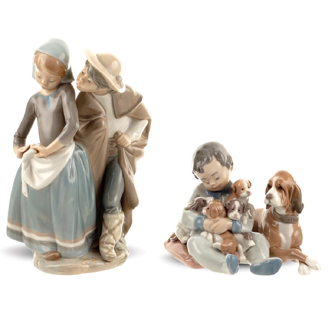 A pair of porcelain figures 20th century h. 14 cm. - 23